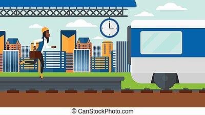 Woman running along the platform.