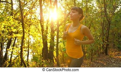 Woman Running at Park on Sunset
