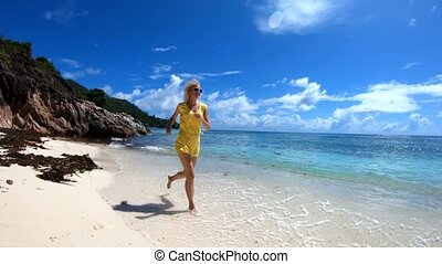 Woman running at Seychelles in SLOW MOTION - SLOW MOTION:...