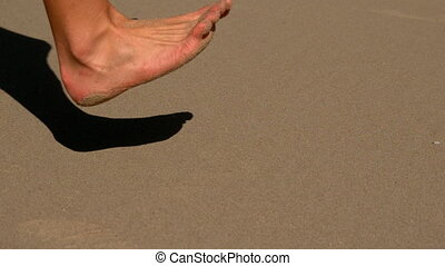 Woman running barefoot on the sand