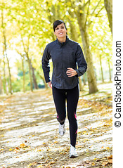 Woman running cheerful outside - Female athlete running...