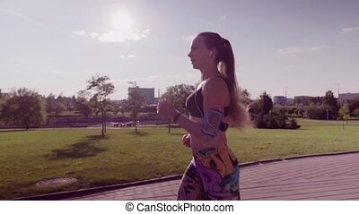 woman running in a city park