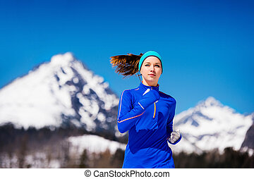 Woman running in mountains - Young woman jogging outside in...