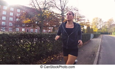 Woman Running in Park in the Autumn