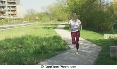 Woman running in park in the morning