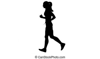Woman running in sport clothing. Side view. Silhouette. White