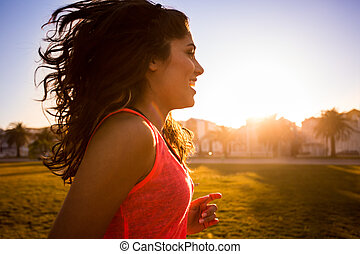 Woman running in the city park