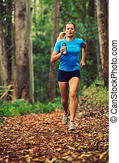 Woman Running in the Forest - Attractive Young Woman Running...