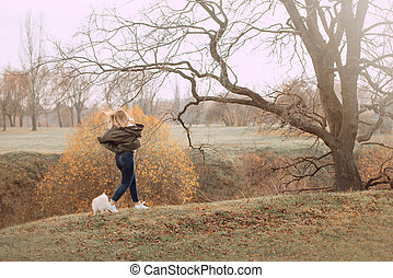 woman running in the park with her dog