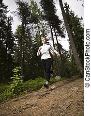 Woman running in the woods