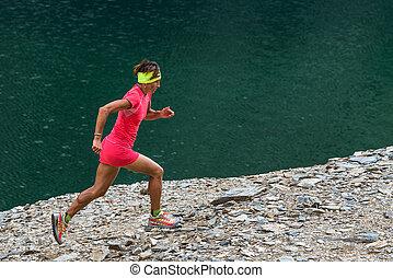 Woman running near a lake