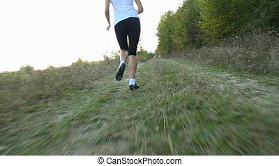 woman running near the forest