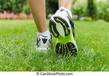 Woman running on grass