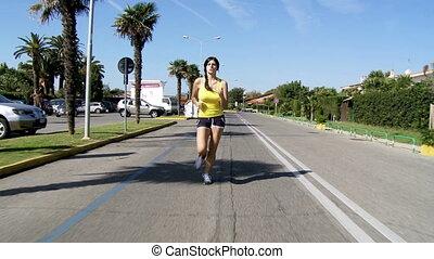 woman running on street happy