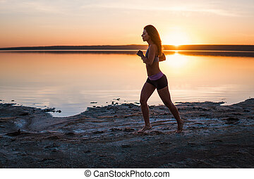 Woman Running on the Beach at Sunset