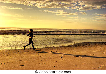 Running on the Beach - Woman Running on the Beach in the...