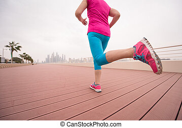woman running on the promenade