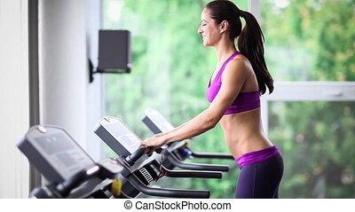 Woman running on treadmill, sports training 5x slow motion