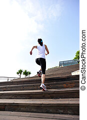 woman running on wooden stairs
