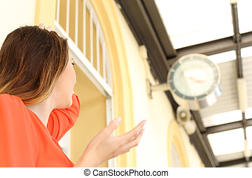 Woman running out of time in a train station delayed concept