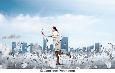 Woman running outdoor with vintage red phone
