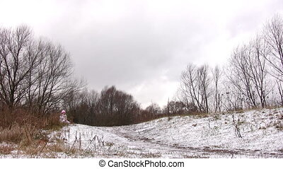 Woman running to camera on first snow way.