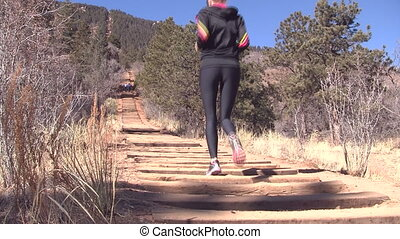 Woman running up Manitou Incline