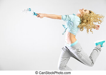 Woman running with a paint roller