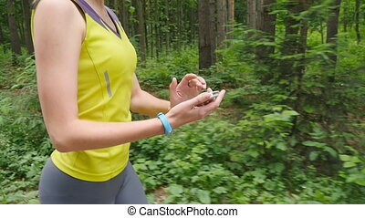 Woman running with fitness tracker
