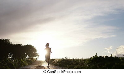 Woman Running With Water Bottle