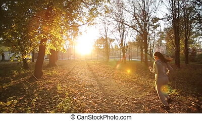woman running in park at sunset