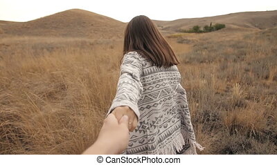 Woman runs holding a man's hand - woman runs holding a man's...