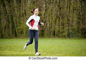 woman runs in green trail