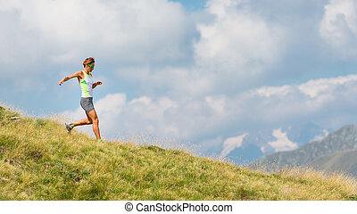 Woman runs in the mountains alone
