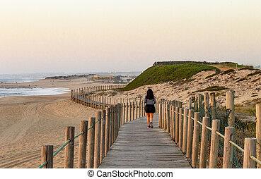 Woman Runs on Boardwalk at the Beach