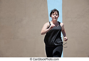Woman runs to keep in shape