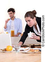 Woman rushing through breakfast
