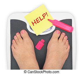 Woman' s feet on bathroom scale