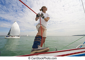 Woman Sailing - Wide angle shot of beautiful young woman on...