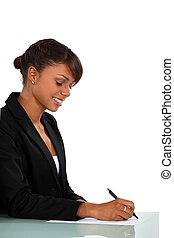 Woman sat at desk writing
