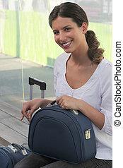Woman sat at train station