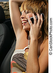 Woman sat in cabriolet at the seaside