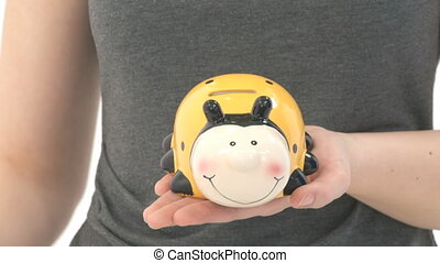 Woman saving money in a savings box
