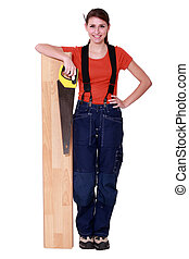 Woman sawing a plank of wood