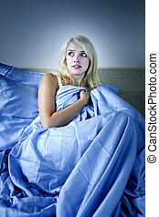 Woman scared in bed - Sleepless blonde woman scared at night...