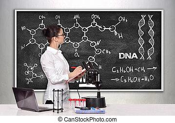 chemical scheme - woman scientific researcher in laboratory ...