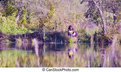 Woman scientist ecologist getting samples of water - Woman...