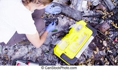 Woman scientists ecologists working on place where the...