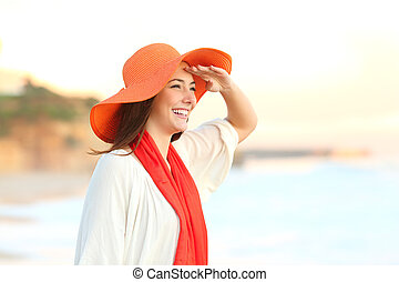 Woman scouting in the beach with hand on forehead