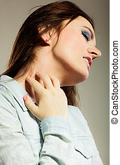 Health problem. Young woman scratching her itchy nack with allergy rash